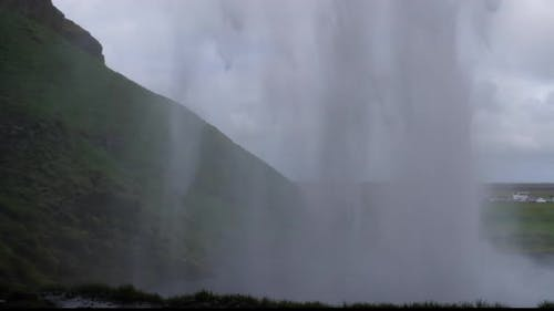 Seljalandsfoss waterfall in Iceland - view from behind