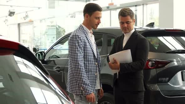 Thumbnail for Serious Men Sign a Car Purchase Contract