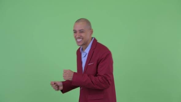 Thumbnail for Happy Bald Multi Ethnic Businessman Dancing