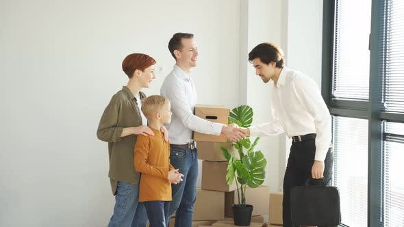 Excited Family Giving High Five to Professional Realtor or Agent Closing Deal Satisfied Family