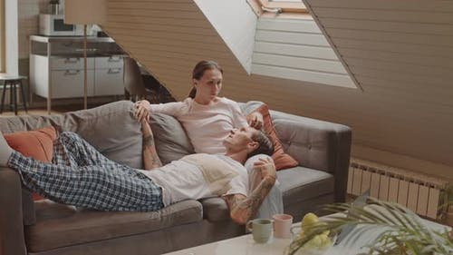 Spouses Relaxing on Couch