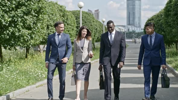 Thumbnail for Business Team Walking along Avenue