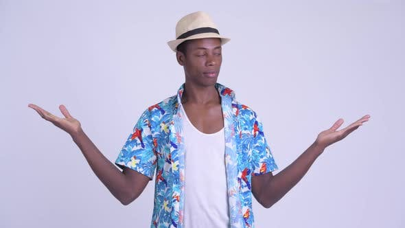 Thumbnail for Young Happy African Tourist Man Comparing Something