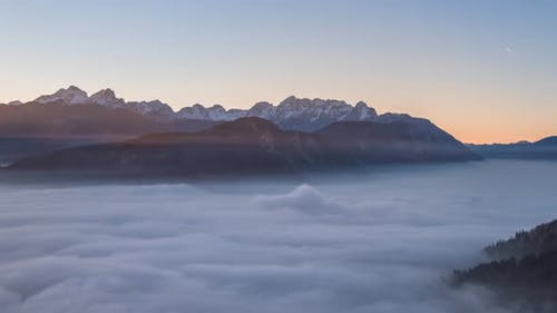 Sunset With Rolling Fog In The Mountains In The Julian Alps