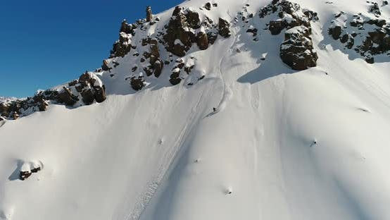 Thumbnail for Amazing Drone Aerial View of Snowboarding Downhill Through Steep Terrain in Chile's Andes Mountains