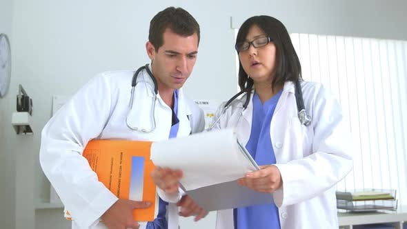 Thumbnail for Two doctors reviewing test results