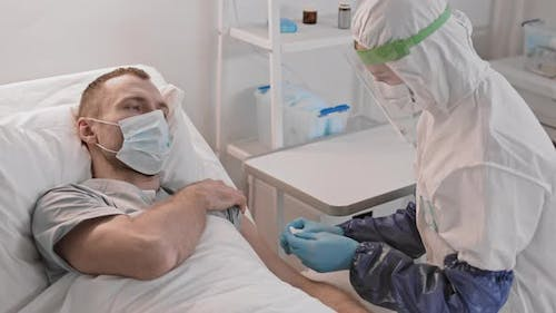 Doctor Giving Injection to Hazardous Patient