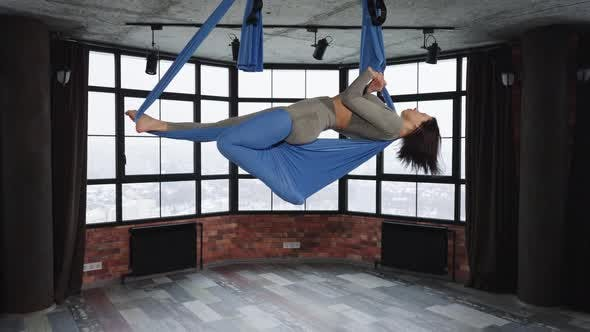 Woman Making Asana in Fly Yoga Class