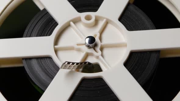 Reel Reels Off Film. Close Up