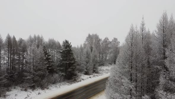 Drone Fly Up Above Winter Forest and Highway