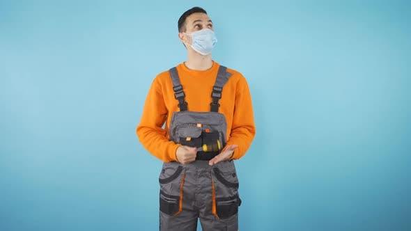 Thoughtful Male Worker Medium Shot Isolated on Blue Studio Background