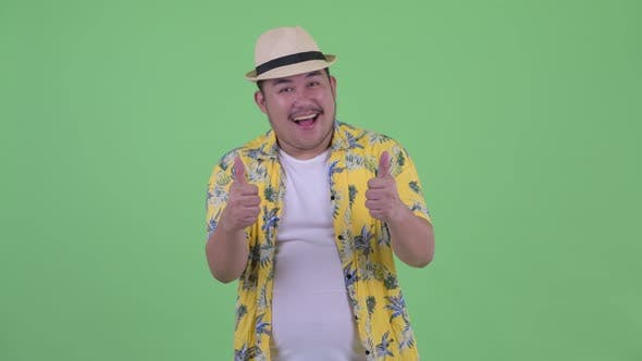 Thumbnail for Happy Young Overweight Asian Tourist Man Giving Thumbs Up and Looking Excited