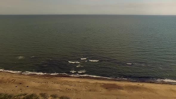 Baltic Sea Coastline In Overcast Day. Polluted, Empty Beach In Baltic Countries.