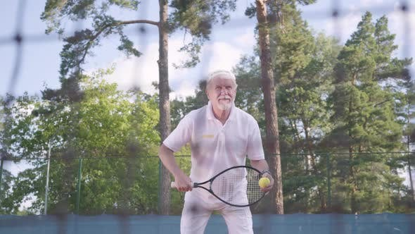 Thumbnail for Joyful Happy Smiling Mature Man Playing Tennis on the Tennis Court
