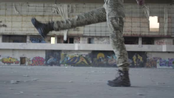 Thumbnail for Female Legs in Military Uniform Marching on the Concrete Floor in Dusty Dirty Abandoned Building