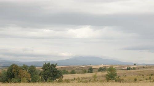 Mountains of Stol and Deli Jovan on cloudy day slow tilt 4K 2160p 30fps UltraHD footage - Autumn lan