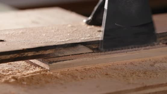 Thumbnail for Woodworker cutting a piece of wood using a jigsaw