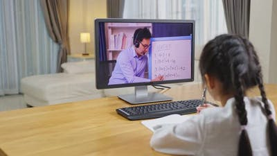 Homeschool Asian girl learn online class with virtual video conference using computer laptop.