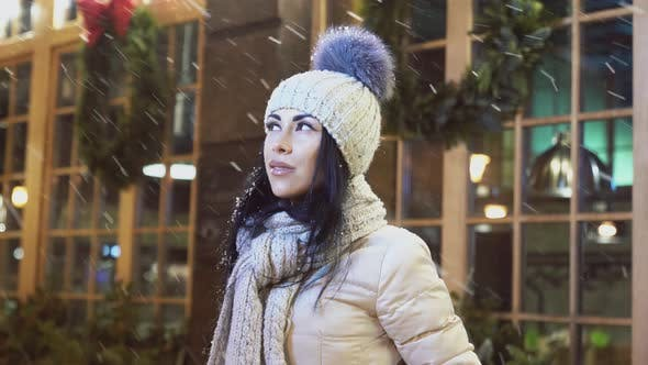 Thumbnail for Positive Girl Looking Up on Snow Near Coffee House.