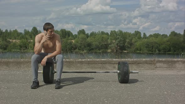 Thumbnail for Athletic Bearded Man with Muscular Body Having Phone Call After Training Outdoor