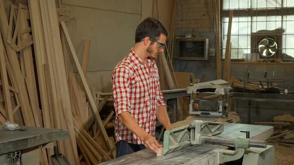 Thumbnail for Young Male Carpenter Grinding Wood Piece at His Workshop 1080p