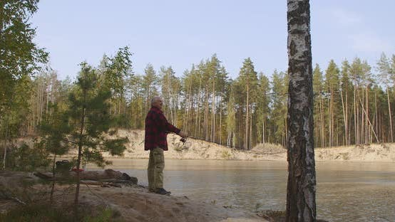 Thumbnail for Relaxed Man Is Enjoying Fishing in Ecological Place, Casting Rod in Water of Clean Lake, Resting in