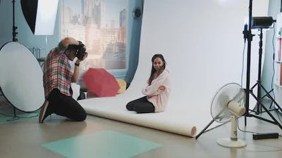 In Wellequipped Studio Photo Shoot Young Photographer Taking Photos of Beautiful African Model