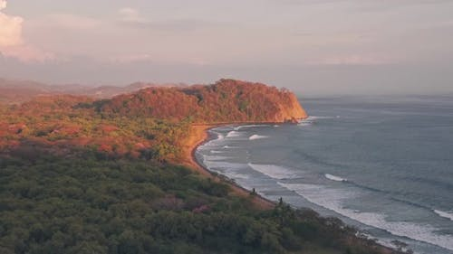 Playa Buena Vista Beach and rainforest at sunset, Guanacaste Province, Costa Rica. Aerial drone view