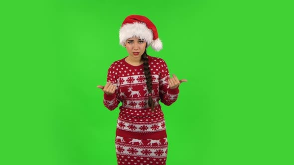 Thumbnail for Sweety Girl in Santa Claus Hat Is Showing Gesture Come Here. Green Screen