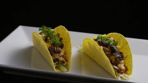 Rotating shot of delicious, fish tacos