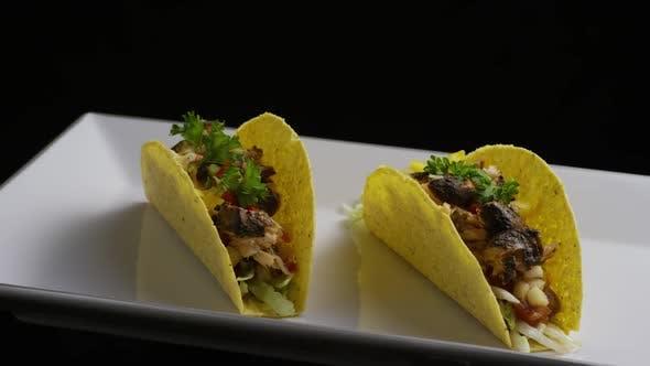 Thumbnail for Rotating shot of delicious, fish tacos