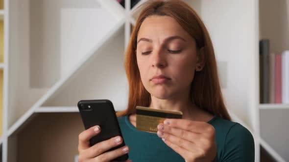 Beautiful Woman Online Banking Using Smartphone Shopping Online with Credit Card at Home Lifestyle