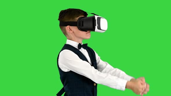 Thumbnail for Excited Boy in Formal Wear Playing the Sword Game in Virtual Reality Goggles on a Green Screen