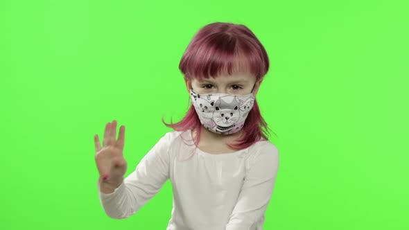 Thumbnail for Little Girl in Medical Face Mask. Isolation. World Pandemic COVID-19 Coronavirus