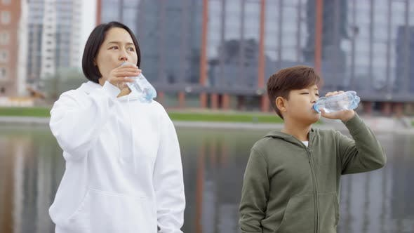 Thumbnail for Asian Mother and Son Drinking Water after Morning Run