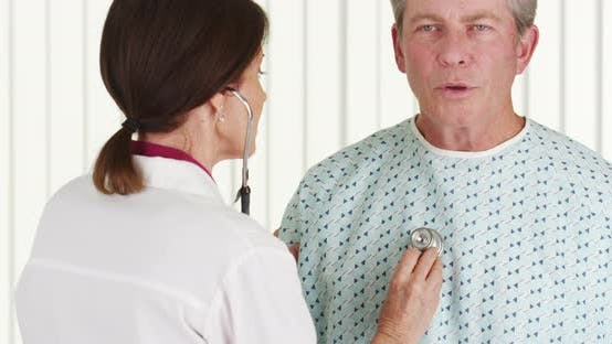 Thumbnail for Woman doctor listening to elderly patient breathing