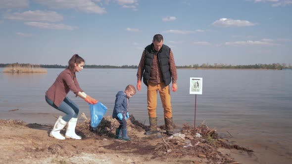 Thumbnail for Environmental Solutions, Child Boy Helps Mother and Father Volunteer Activists Clean Up Dirty River