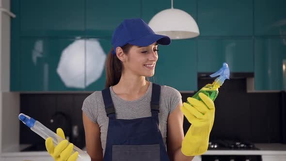 Thumbnail for Woman in Workwear Choosing Green Detergent Among Two Cleaning Agents Being