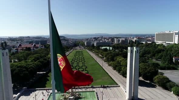 Thumbnail for Portuguese Waving Flag In Eduardo VII Park In Lisbon, Portugal Drone Shot