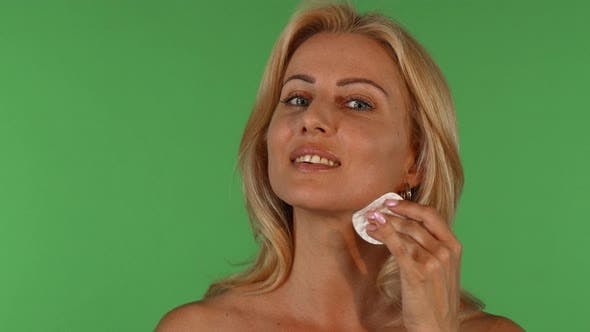 Thumbnail for Attractive Mature Woman Wiping Her Face with a Cotton Pad