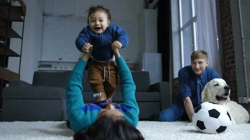 Little Baby Boy Flying with Help of Mom's Hands