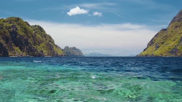 Ocean Strait Rippled Surface Between Matinloc and Tapiutan Islands. Island Hopping Tour C. Bacuit