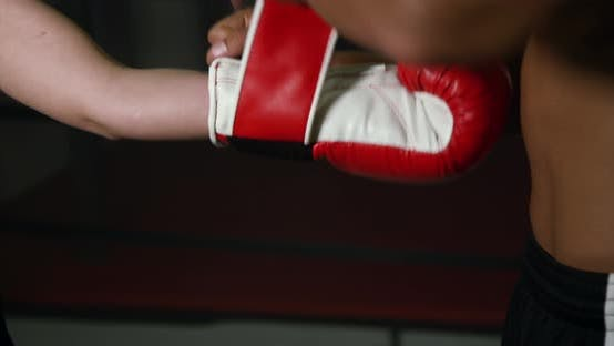 Thumbnail for Coach Helps Women Boxer To Put On Gloves 17