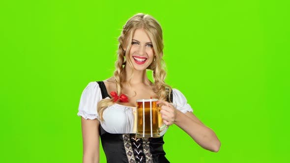 Thumbnail for Girl in Bavarian Costume Is Luring Someone for a Glass of Beer. Green Screen
