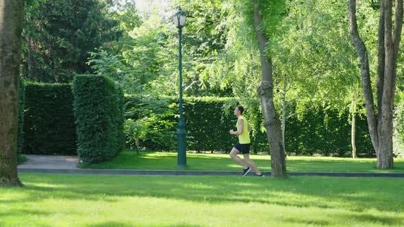 Man Jogging Against Garden Maze in Slow Motion