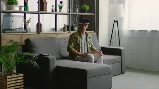 Thumbnail for Man Enjoys Wearing Virtual Reality Headset, Using Gestures To Control Images