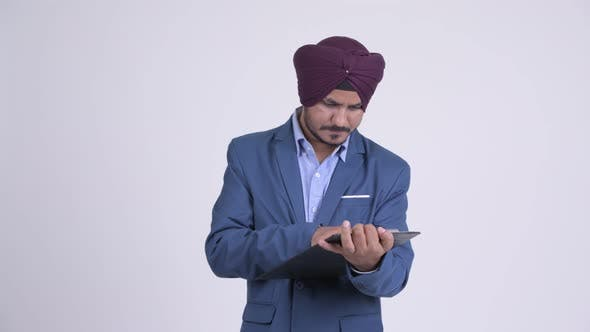 Thumbnail for Happy Indian Sikh Businessman Showing Clipboard and Giving Thumbs Up