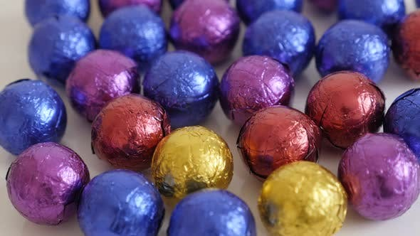 Slow tilt on colorful candies close-up  3840X2160 UltraHD footage - Round Christmas chocolate treats