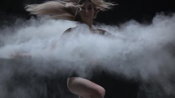Thumbnail for Close-up Dancer with Perfect Body Throwing Dust Particles in Air. Slow Motion