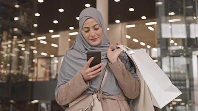 Arabic Woman in Hijab at Shopping Mall